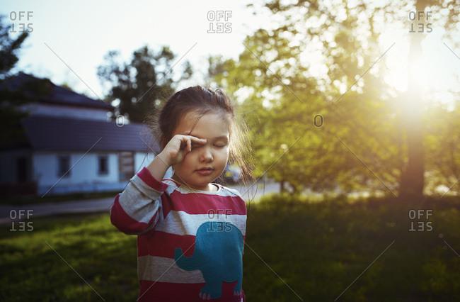 Girl rubbing her eyes