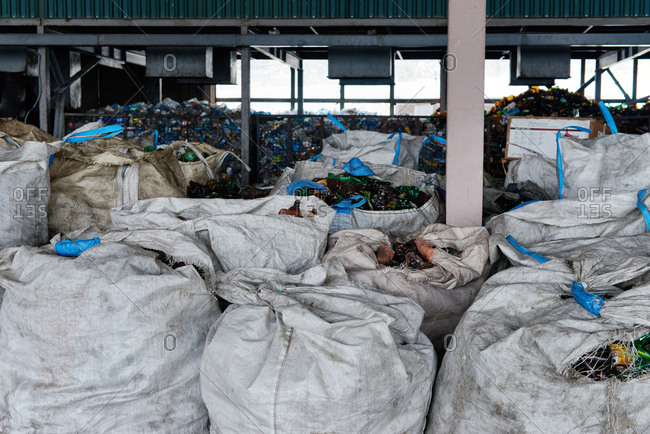 Chelyabinsk region,  Russia - March 31, 2017: Sacks filled with empty plastic bottles prepared for disposal lying at waste sorting plant