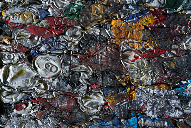 Compressed garbage. Close-up view of compacted aluminum cans ready for recycle