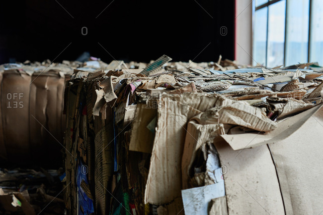 Recyclable material. Close up view of compressed cardboard prepared for reuse