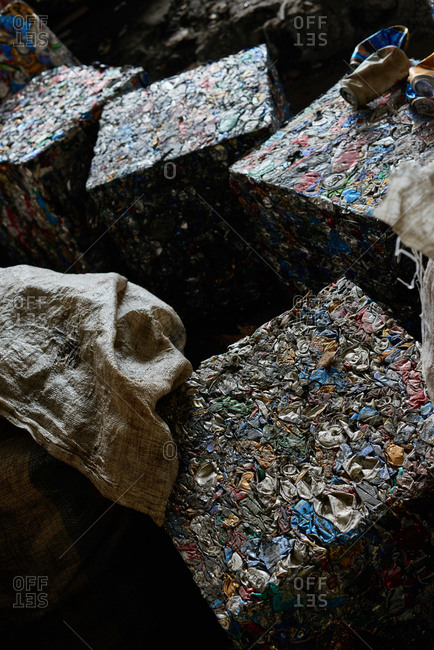 Smart waste management. Blocks of compacted recyclable garbage lying at waste sorting plant, high angle view