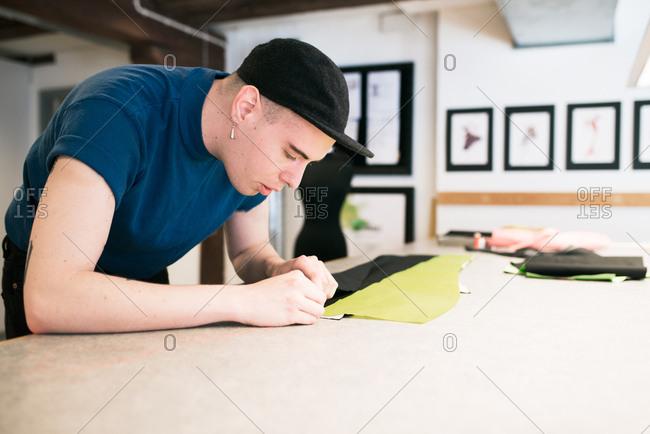 Man making garment in a workshop