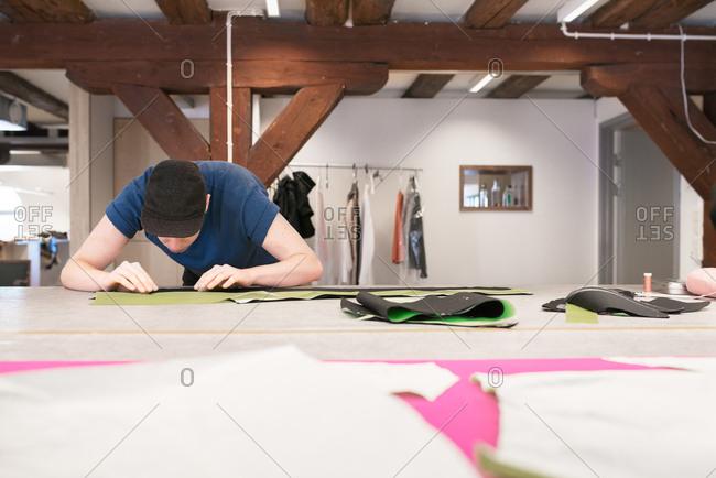 Man making garment in studio