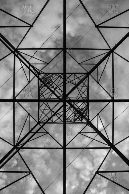 Clouds and sky seen from beneath a geometric metal structure