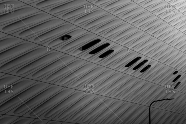 Streetlight and rows of geometric panels with oval indentions