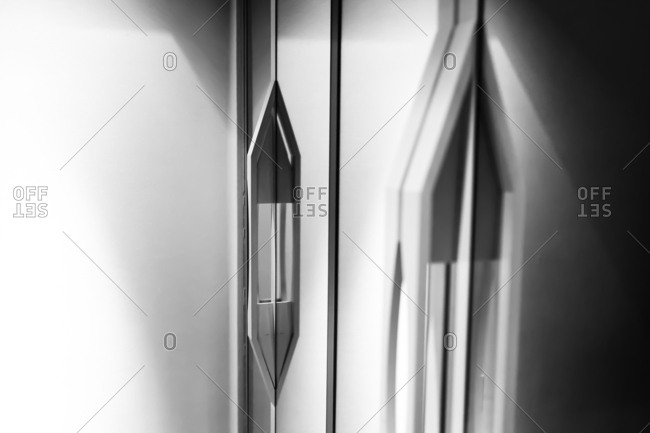 Geometric handle on a sleek, modern door