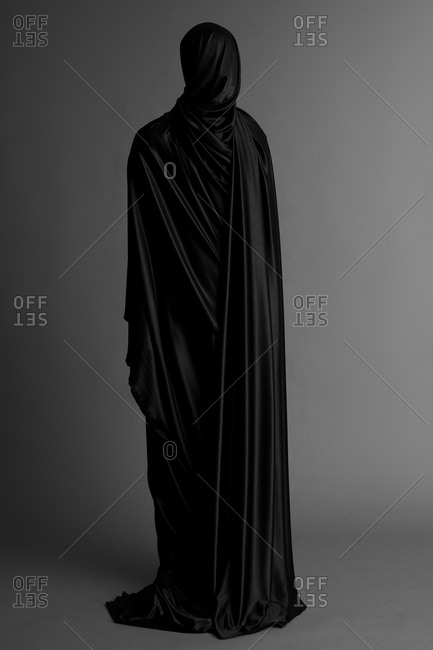 Human figure wrapped completed in black fabric