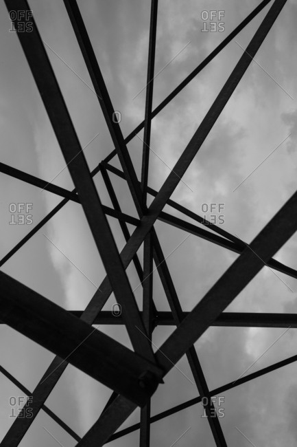 Intersecting metal poles beneath an overcast sky
