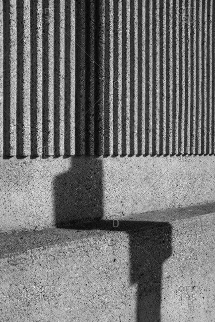 Shadow distorted on a concrete surface with ridges