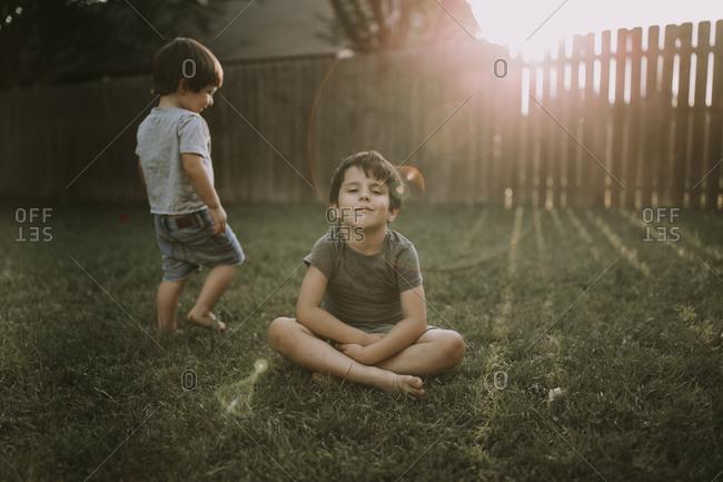 Two boys in a summer yard