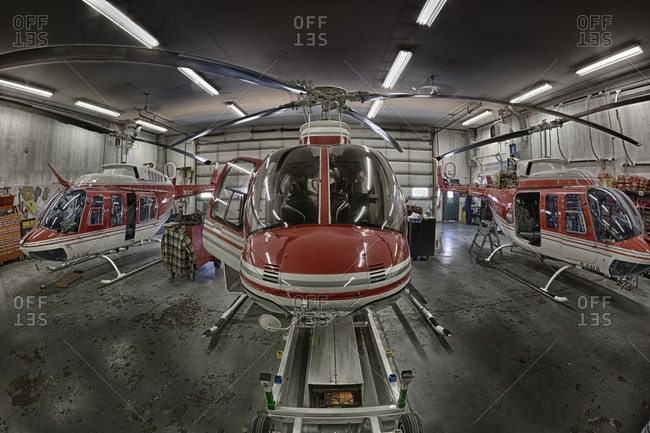 Alberta, Canada - May 6, 2013: Helicopter sits in hangar before flight