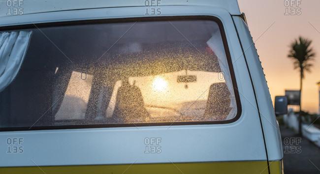 View of sunrise and camper van, tropics