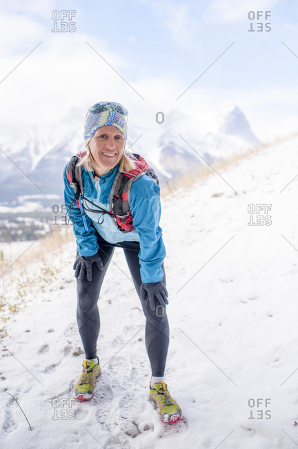 Portrait of cross country runner, mountains