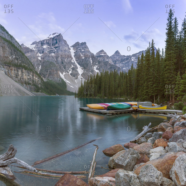Moraine Lake with canoes at shoreline