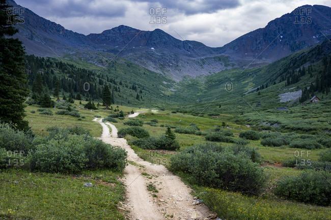 Backcountry mountain road through a valley in Colorado