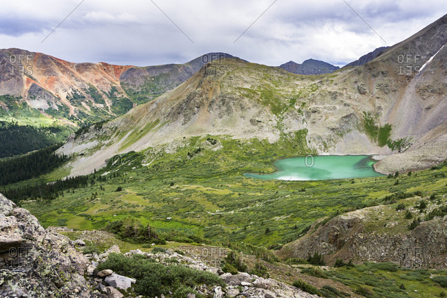 A high alpine lake in the Colorado backcountry during the spring