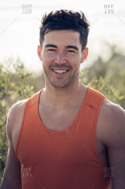 Portrait Of A Happy Young Man With Muscular Build