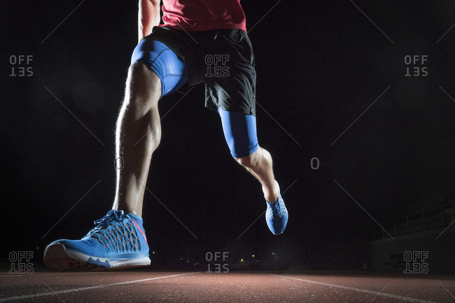 Close-up Of A Male Athlete Running On Race Track