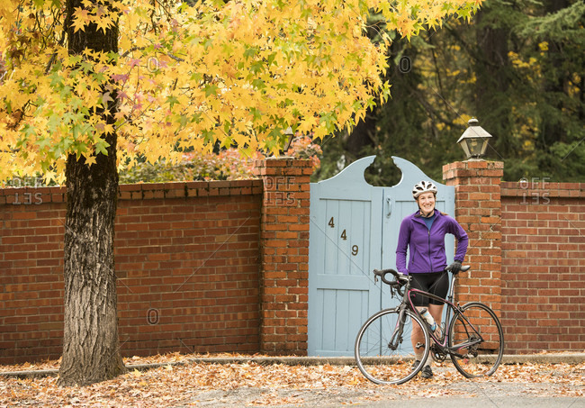 Autumn scene of woman standing by bicycle in Nevada City