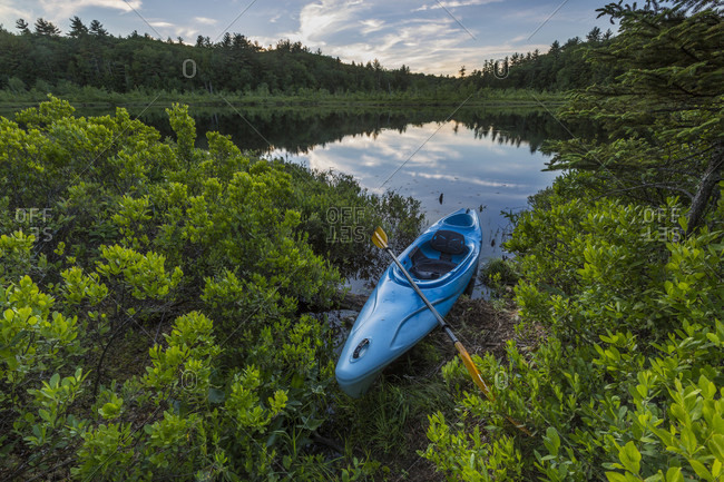 A Kayak On The Shore Of Round Pond In Barrington, New Hampshire