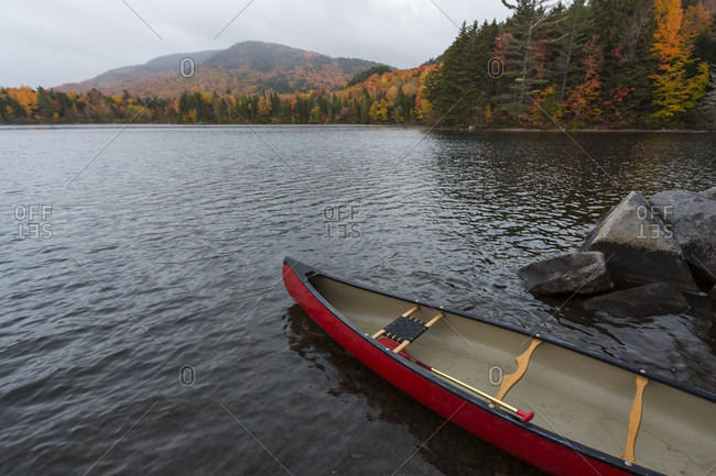 A Canoe On The Shore Of Greenough Pond In Wentworths Location, New Hampshire