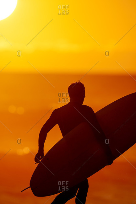 Close-up Of A Male With Surfboard At Sunset