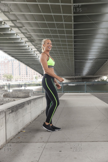Fit Woman Wearing Workout Clothes Laughing Outside