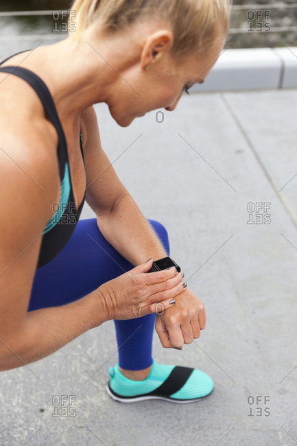 Fit Woman Checking Her Fitness Tracker Watch