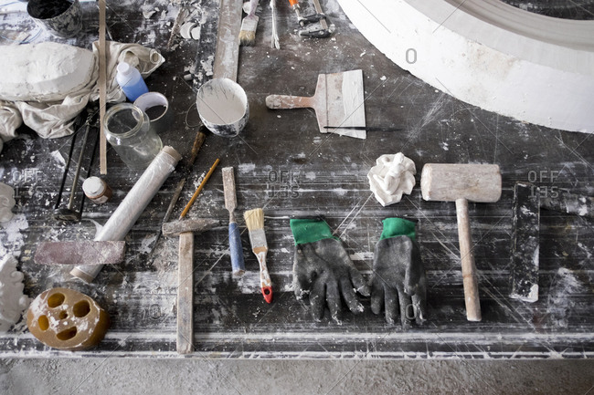 Painting and sculpting tools on messy table