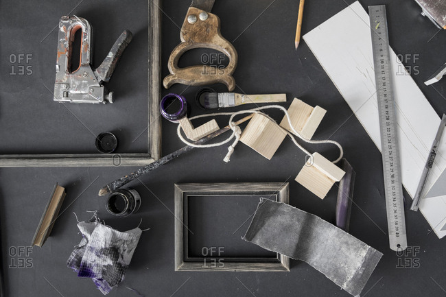 Picture frame and tools on table