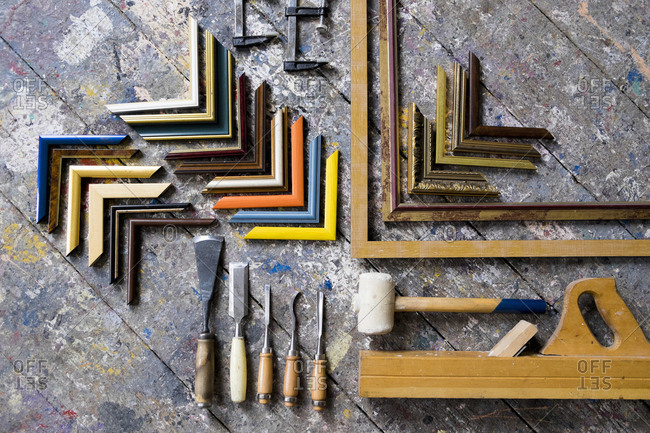 Picture frame tools on splattered table
