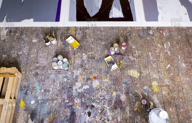 Paint supplies on floor of art studio