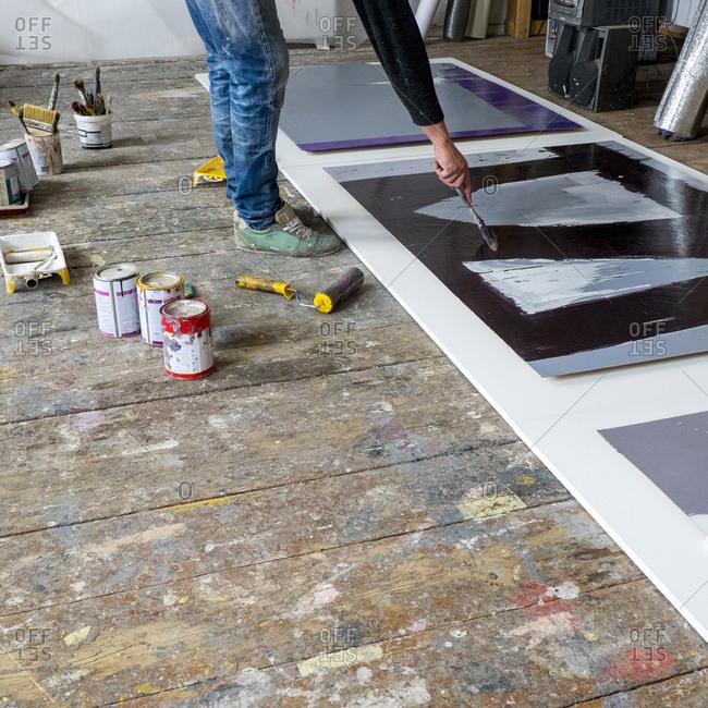 Caucasian artist painting with paintbrush