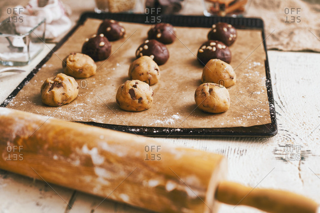 Cookie dough on baking sheet near rolling pin