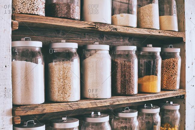 Jars of ingredients on wooden shelves