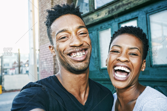 Portrait of smiling Black couple in city