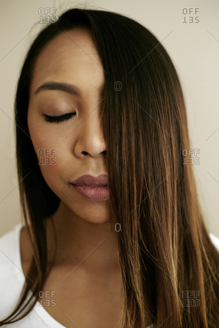 Hair of Asian woman covering half of face