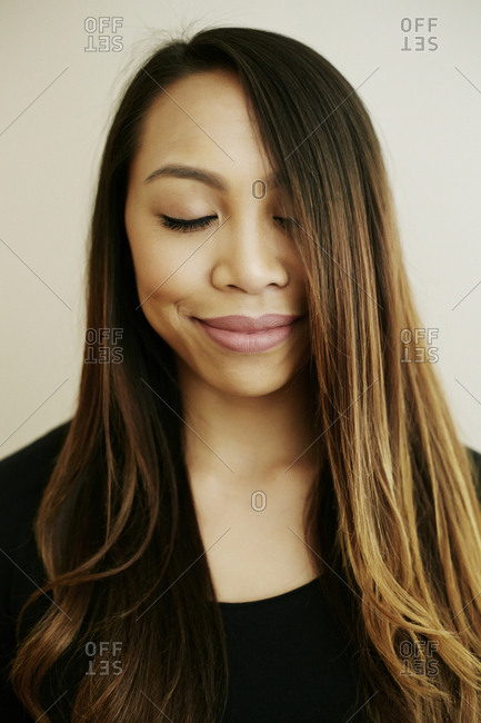 Portrait of smiling Asian woman with eyes closed