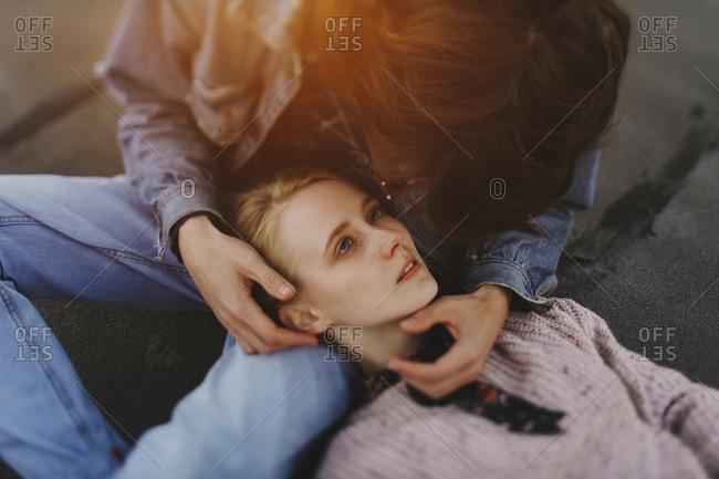 Caucasian woman laying in lap of man