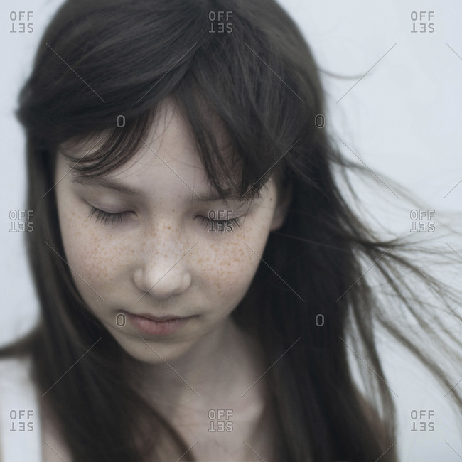 Wind blowing hair of Caucasian girl