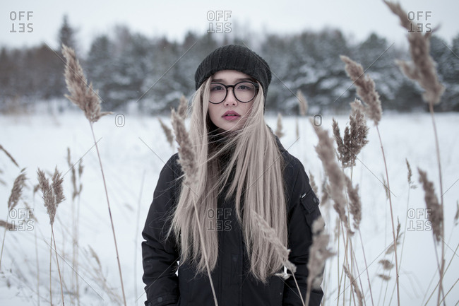 Wind blowing hair of Asian woman in winter