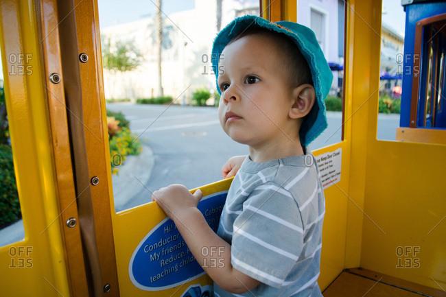 Toddler boy riding on train ride