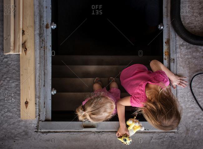 Two little girls on cellar steps