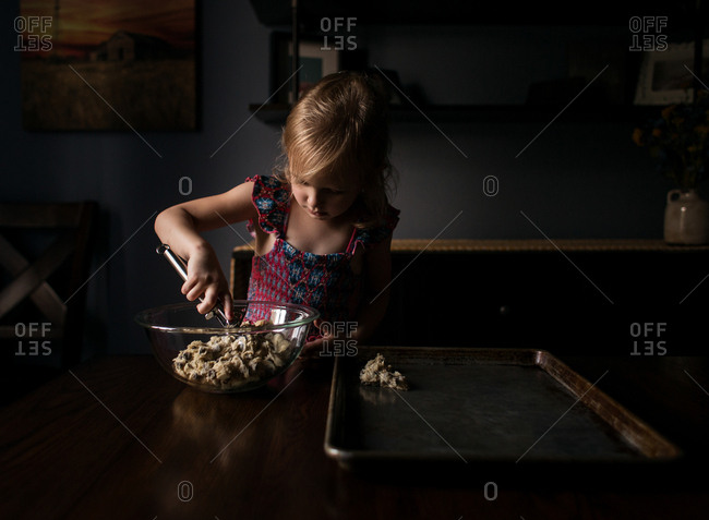 Little girl making chocolate chip cookies