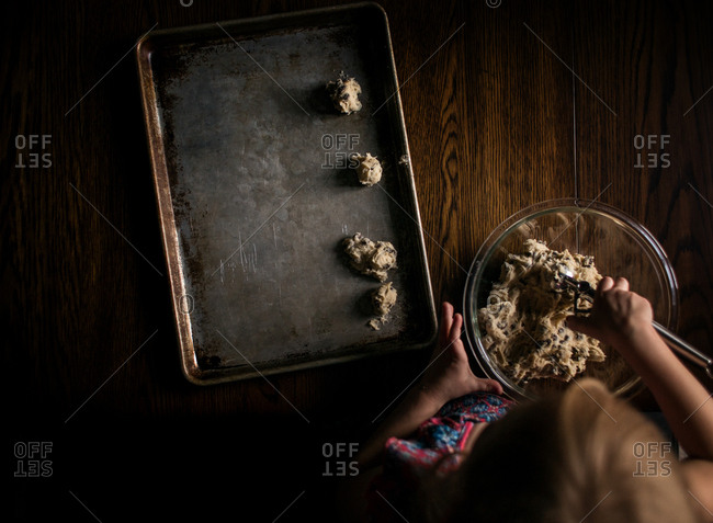 Overhead view of girl making chocolate chip cookies