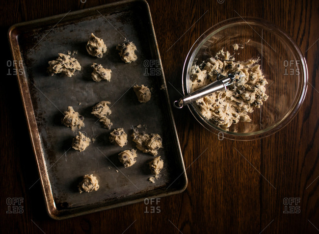 Chocolate chip cookie dough in a bowl and on a pan