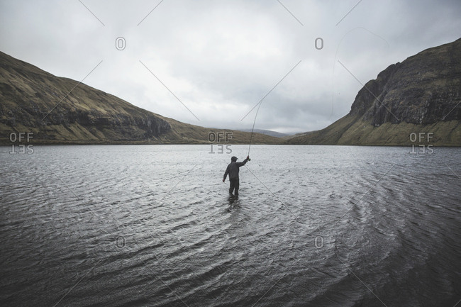 Mykines, Faroe Islands - May 10, 2016. A person is fishing in a lake at the Faroe Islands.