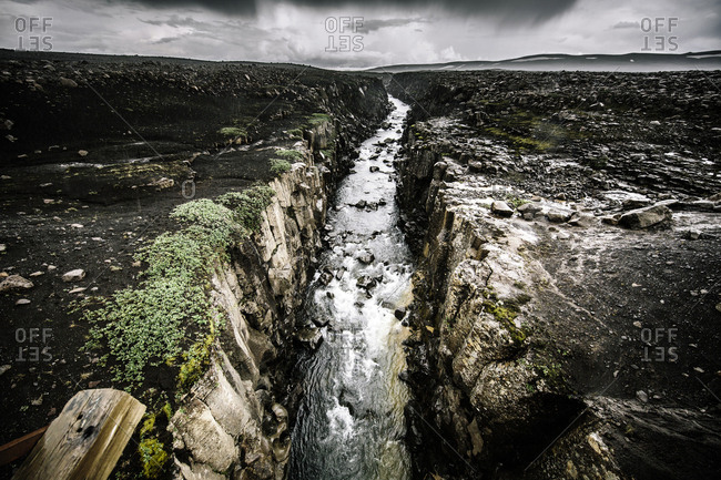 Iceland - July 26, 2015. A river runs deep in a canyon.