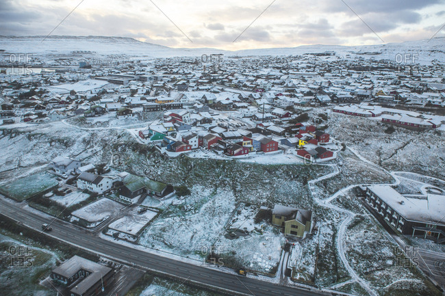 Torshavn, Faroe Islands - November 20, 2015. The largest city and the capital of the Faroe Islands Torshavn surrounded by a beautiful snowy landscape.