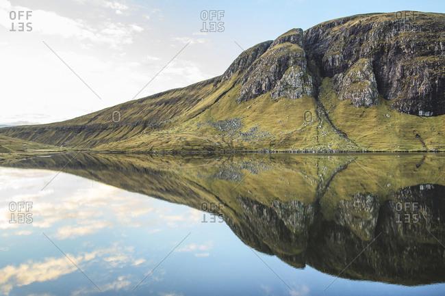 Faroe Islands - November 19, 2015. A lake surrounded by a rocky landscape in the Faroe Islands.